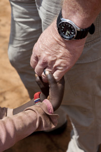 missionary_holding_hand